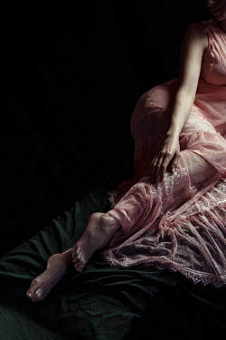 Natasza Fiedotjew Woman lying in lacy dress