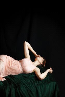 Natasza Fiedotjew Woman lying in pink dress