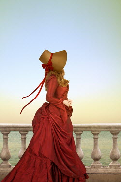 Victoria Davies Young woman in Victorian red dress and bonnet