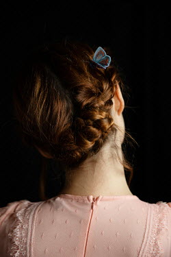 Natasza Fiedotjew Butterfly on red pinned up hair of young woman