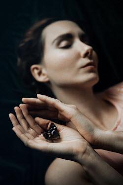 Natasza Fiedotjew brunette woman holding butterfly Women