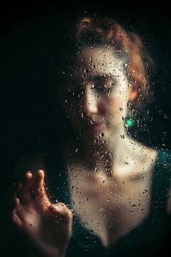 Natasza Fiedotjew Young woman in gown behind wet glass