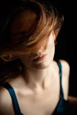 Natasza Fiedotjew Young redhead woman with blown hair
