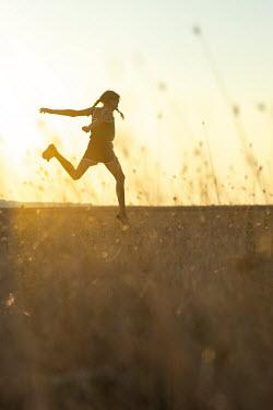 Galya Ivanova Girl running in field during sunset