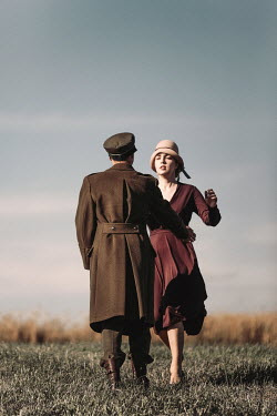 Magdalena Russocka wartime couple running toward each other in countryside