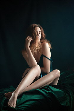 Natasza Fiedotjew Young redhead woman sitting on bed