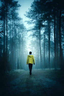 Natasza Fiedotjew Young man in yellow raincoat walking in woods
