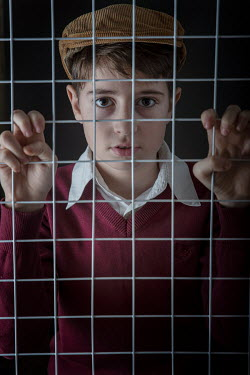 Galya Ivanova BOY IN CAP BEHIND WIRE MESH Children