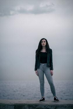 Mohamad Itani GIRL IN LEATHER JACKET STANDING ON SEA WALL Women