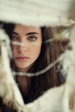 Mohamad Itani GIRL WITH DARK HAIR PEERING THROUGH RIPPED FABRIC Women