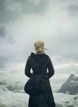 Mark Owen BLONDE WOMAN WATCHING SNOWY MOUNTAIN LANDSCAPE Women