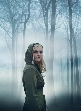 Mark Owen BLONDE HOODED WOMAN IN FOGGY FOREST Women