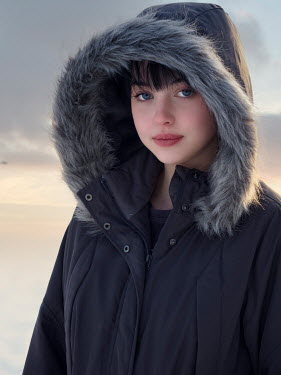 Elisabeth Ansley SERIOUS GIRL WITH FUR HOOD OUTDOORS Women