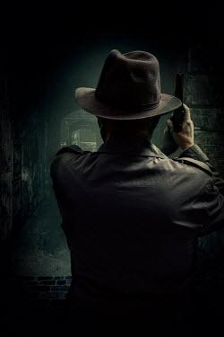 Jaroslaw Blaminsky MAN WITH HAT AND GUN IN DARK BUILDING Men