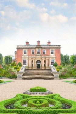 Lee Avison garden paths converging towards a historic house