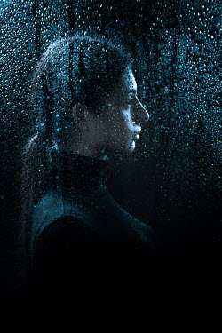 Magdalena Russocka young woman behind wet glass
