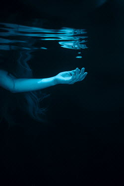 Magdalena Russocka woman's arm and hair underwater
