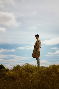 Miguel Sobreira MAN WITH COAT IN COUNTRYSIDE WITH BLUE SKY Men