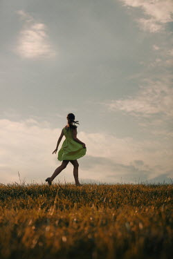 Magdalena Russocka teenage girl walking in field at sunset