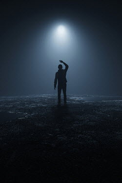 Andrei Cosma SILHOUETTED MAN WITH GLOWING LIGHT AT NIGHT OUTDOORS Men