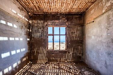 James Kerwin INTERIOR OF DERELICT HOUSE IN DESERT Interiors/Rooms