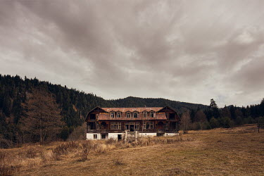 James Kerwin LARGE ABANDONED BUILDING BY HILLS AND FOREST Houses
