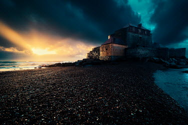 David Keochkerian OLD BUILDING ON BEACH WITH STORMY SKY Houses