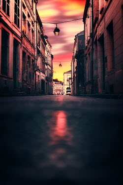 David Keochkerian CITY STREET WITH BUILDINGS AT SUNSET Streets/Alleys