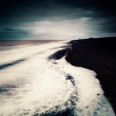 David Keochkerian DISTANT MAN ON BEACH WITH STORMY SKY Seascapes/Beaches