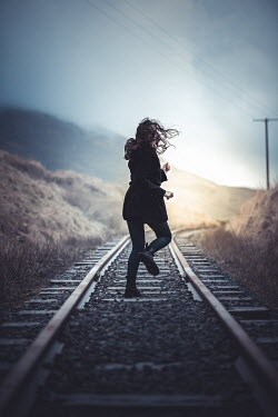 Marie Carr WOMAN RUNNING ON RAILWAY TRACK IN COUNTRYSIDE Women