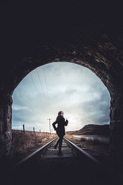 Marie Carr WOMAN RUNNING THROUGH RAILWAY TUNNEL IN COUNTRYSIDE Women