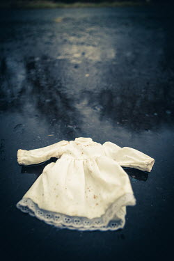 Marie Carr DIRTY CHILD'S WHITE DRESS ON WET ROAD Miscellaneous Objects