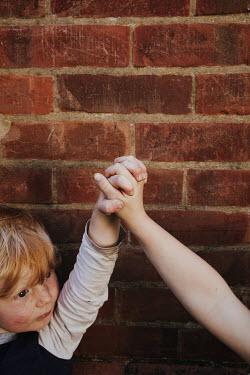 Matilda Delves TWO CHILDREN HOLDING HANDS OUTDOORS Children