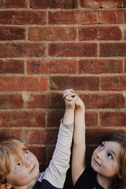 Matilda Delves LITTLE BOY AND GIRL HOLDING HANDS OUTDOORS Children