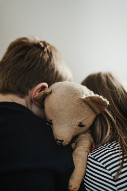 Matilda Delves LITTLE GIRL AND BOY HUGGING TEDDY BEAR Children