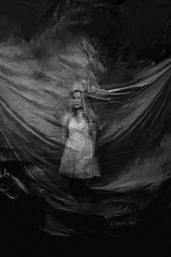 Angela Ward-Brown Young woman behind plastic sheet Women