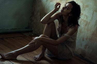 Maria Yakimova Young woman sitting on floor
