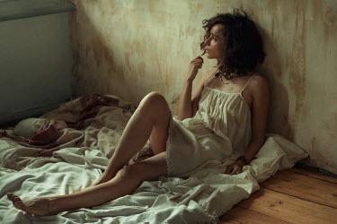 Maria Yakimova Young woman sitting on sheet