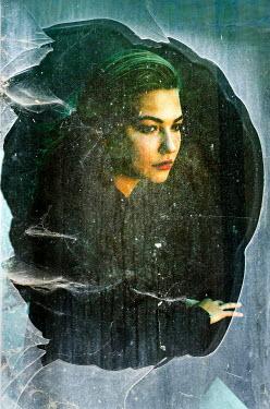 Ute Klaphake Young woman behind broken glass