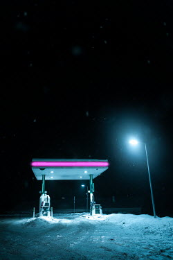 Magdalena Russocka empty gas station at night in winter