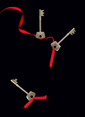 Magdalena Russocka three keys tied with ribbon with one cut off