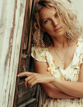 Maria Yakimova Woman leaning on wooden door