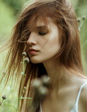 Maria Yakimova Young woman smelling flowers