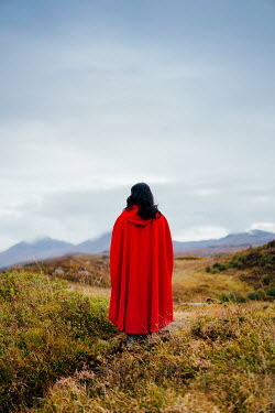 Angela Ward-Brown Woman in red cloak standing in field