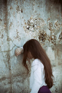 Mohamad Itani Girl leaning on stone wall