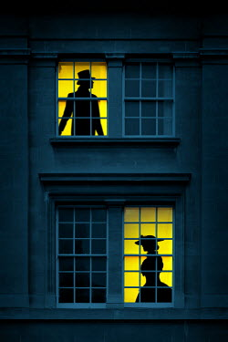 Magdalena Russocka silhouettes of historical man and woman in old building windows