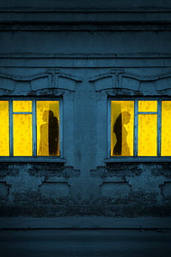 Magdalena Russocka silhouettes of two women in old building windows