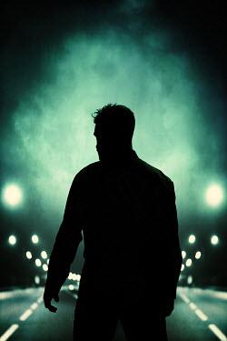 Magdalena Russocka silhouette of modern man standing on motorway at night