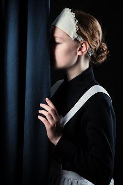 Magdalena Russocka historical maid behind curtain