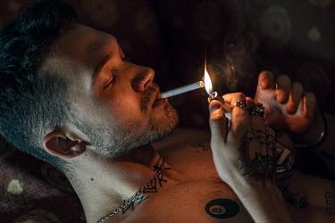 Maria Yakimova Young man lighting cigarette
